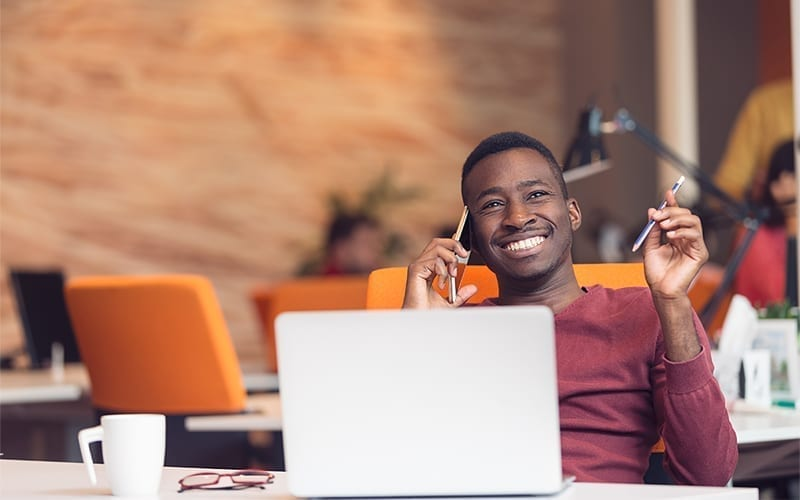 Man smiling with computer